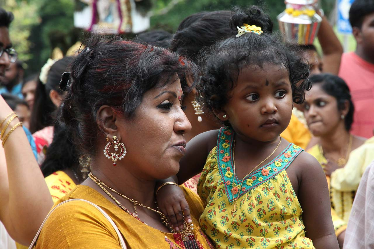 Tamil woman holding toddler