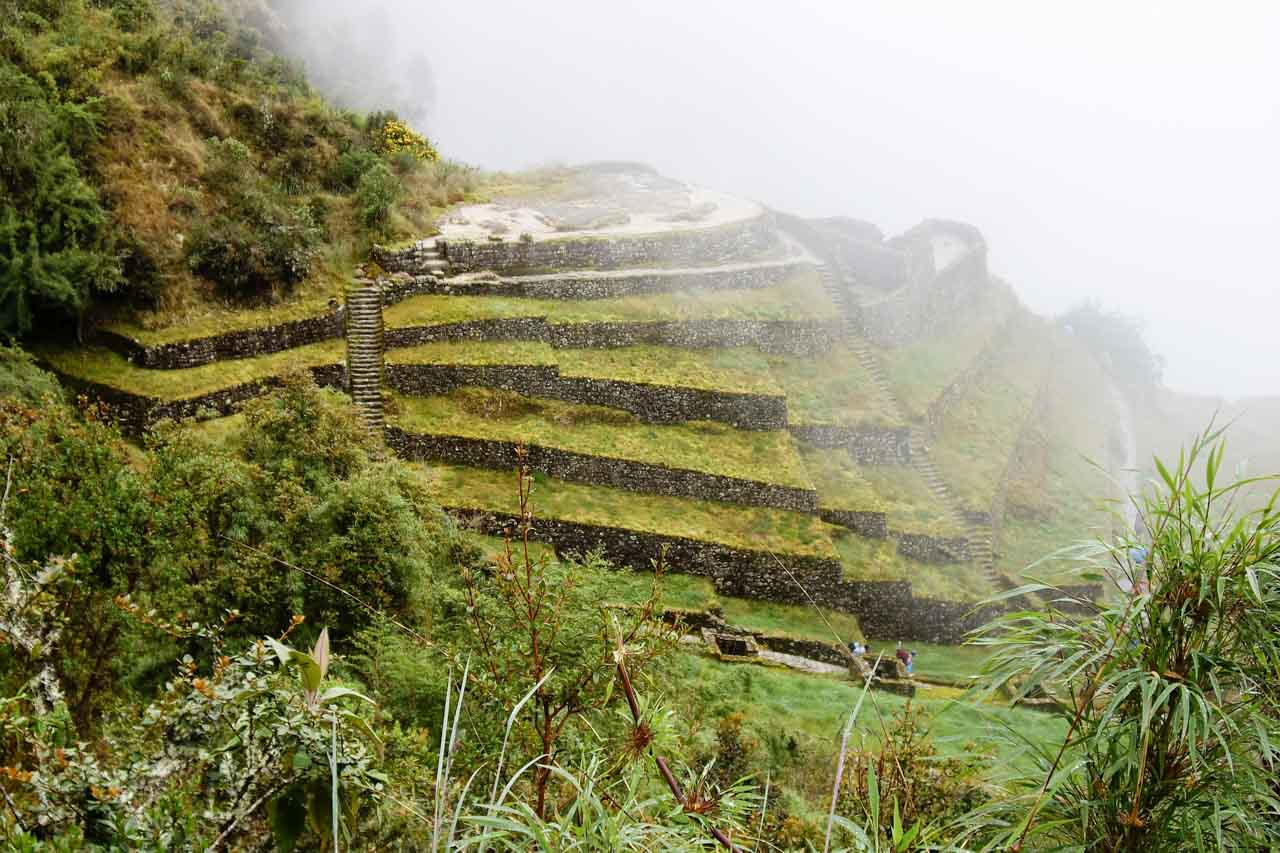 Puyupatamarca, one of the archaeological sites along the Inca Trail, shrouded in mist.