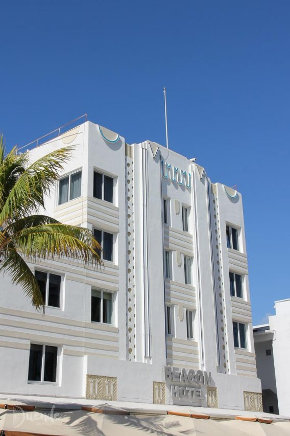 The whit and sand coloured, art deco exterior of the Beacon Hotel, set against blue sky