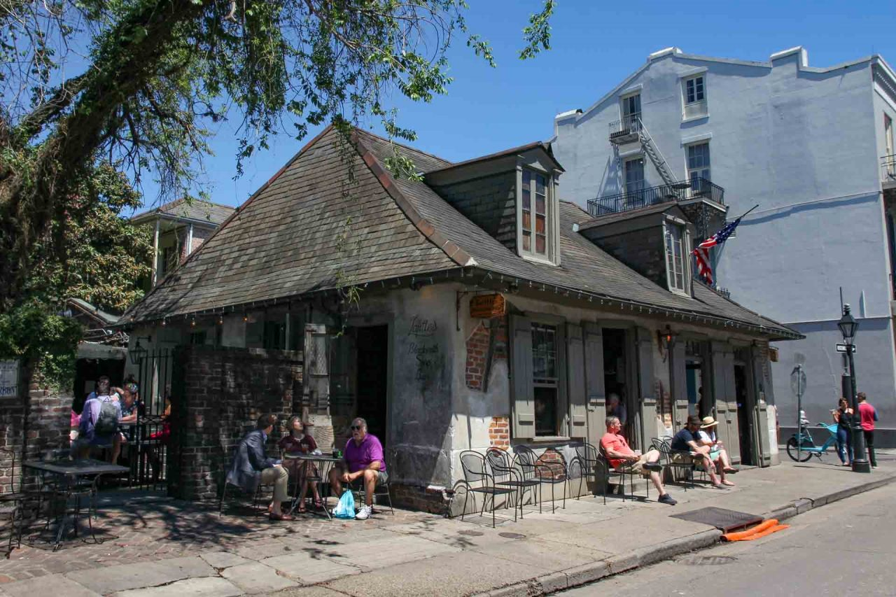 Exterior of Lafitte's Blacksmith Shop with people sitting outside