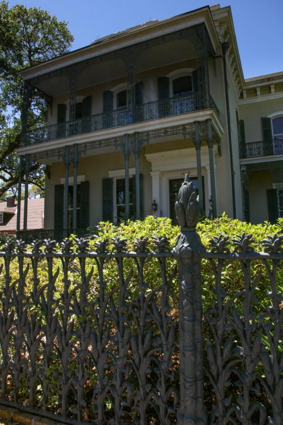 Short-Favrot House viewed from behind cornstalk iron fence and hedge