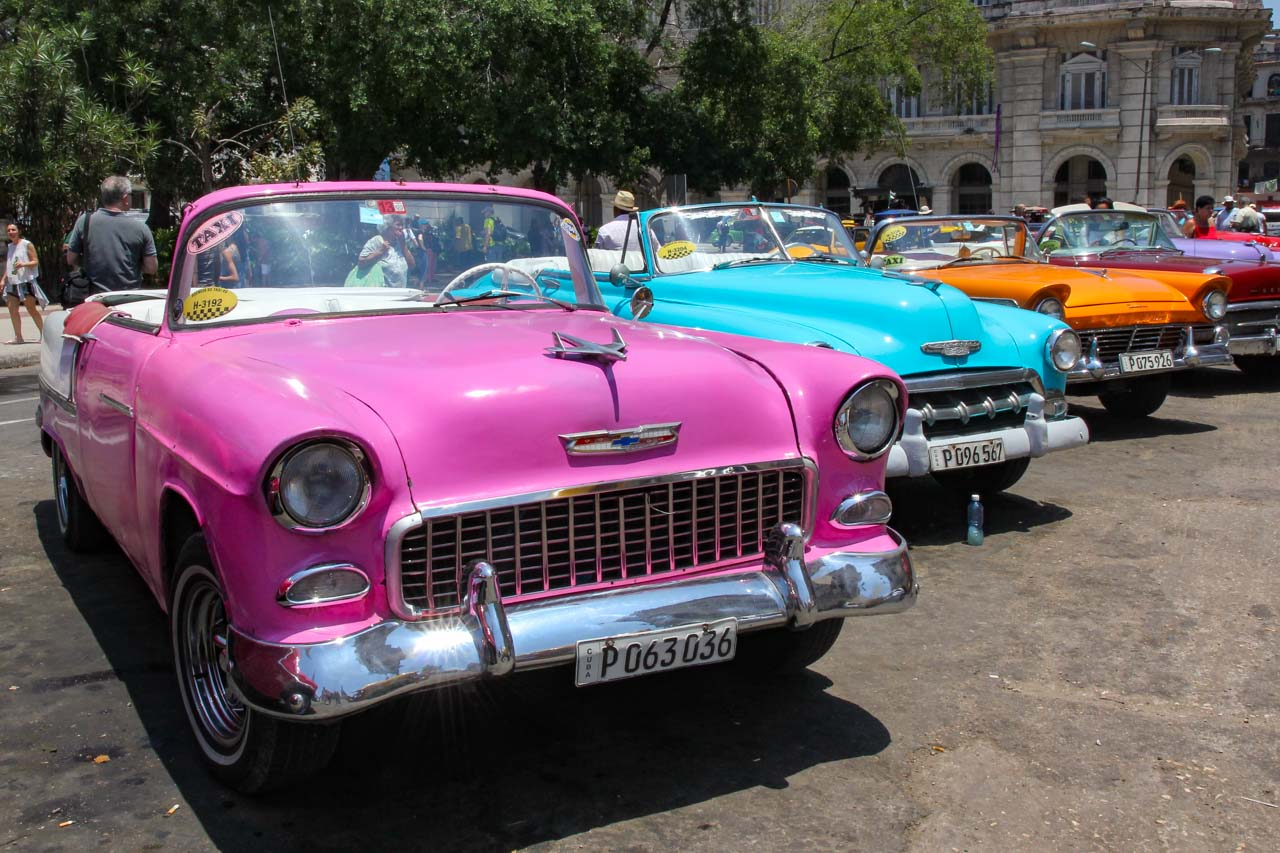 Pink, 1955 Chevy Bel Air convertible in a classic car line up on the street