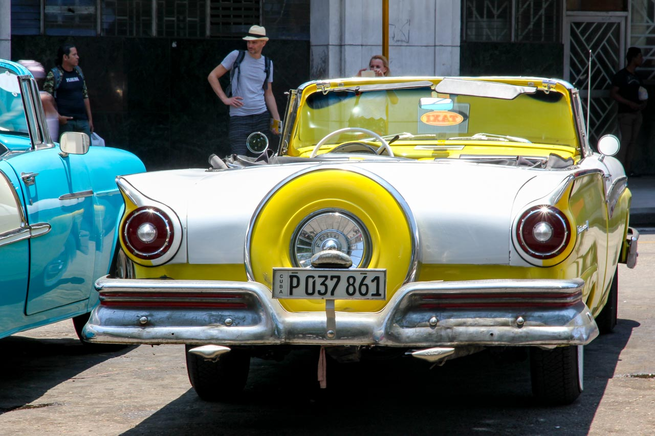 Yellow and white Ford, classic convertible viewed from the rear