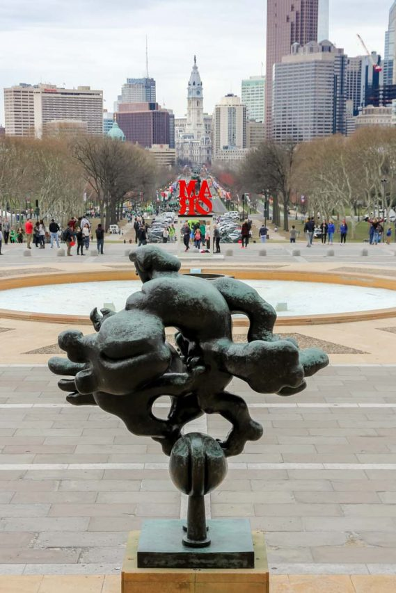 Museum Mile viewed from the Museum of Art toward City Hall with bronze sculpture in foreground