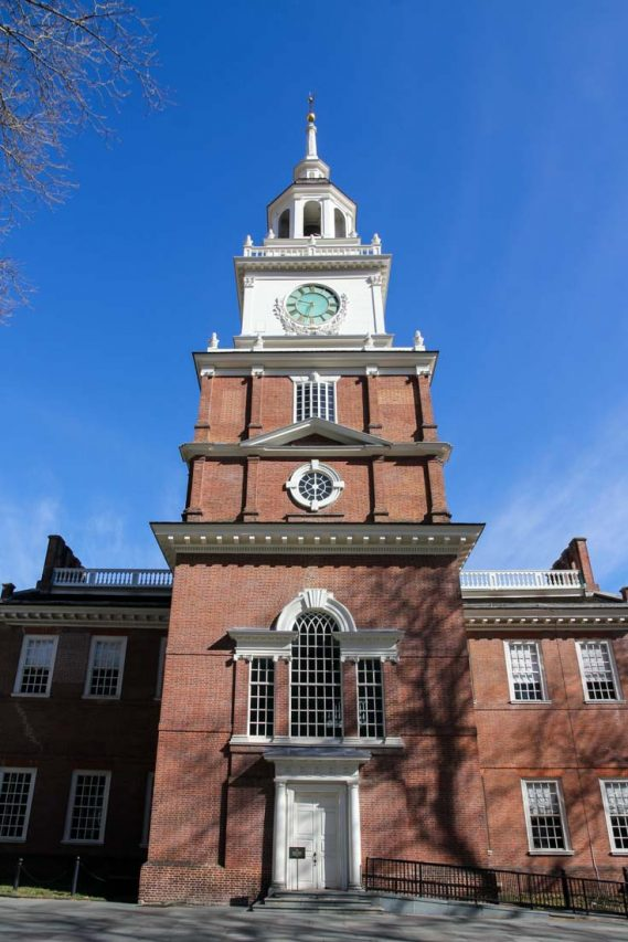 Photo of clocktower of Independence Hall with blue sky