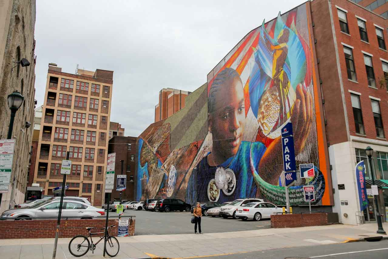 Large scale mural on side of brick building