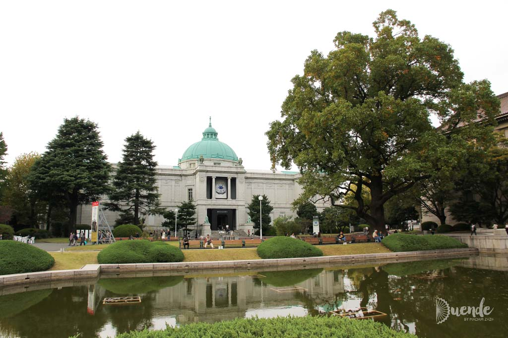Exterior of Tokyo National Museum with trees and reflecting pool