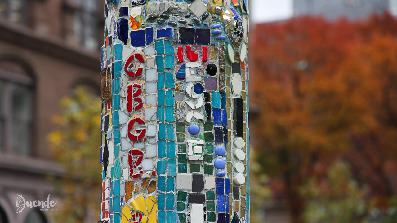 A tile embellished lamp post in Jim Power's Village Mosaic Trail | Art on the Street - NYC II | Duende by Madam ZoZo