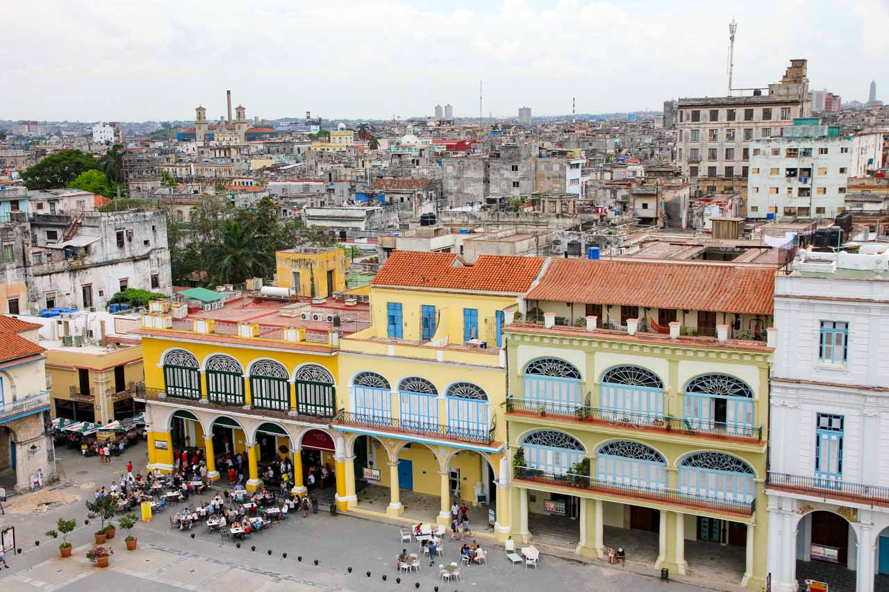 Yellow and blue, restored colonial buildings on edge of plaza