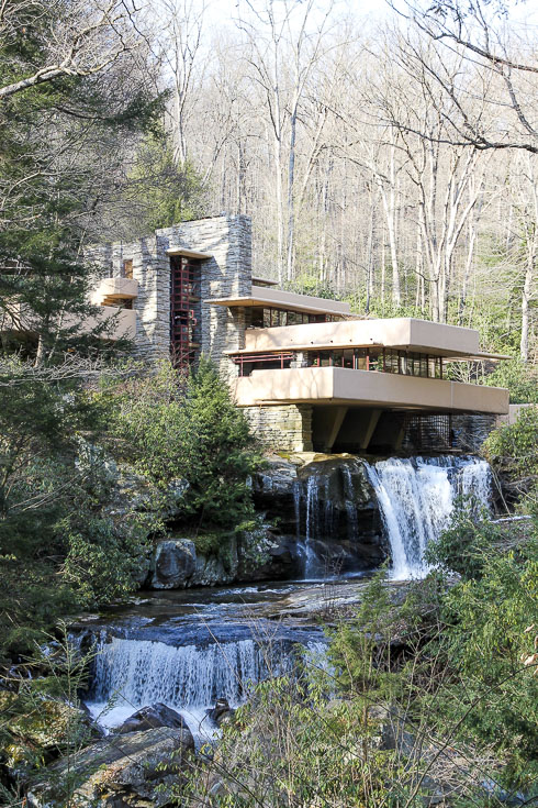 Prairie-style home built over a cascading waterfall
