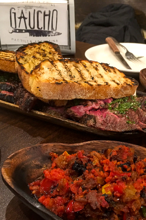 Plates of steak, toast and sides