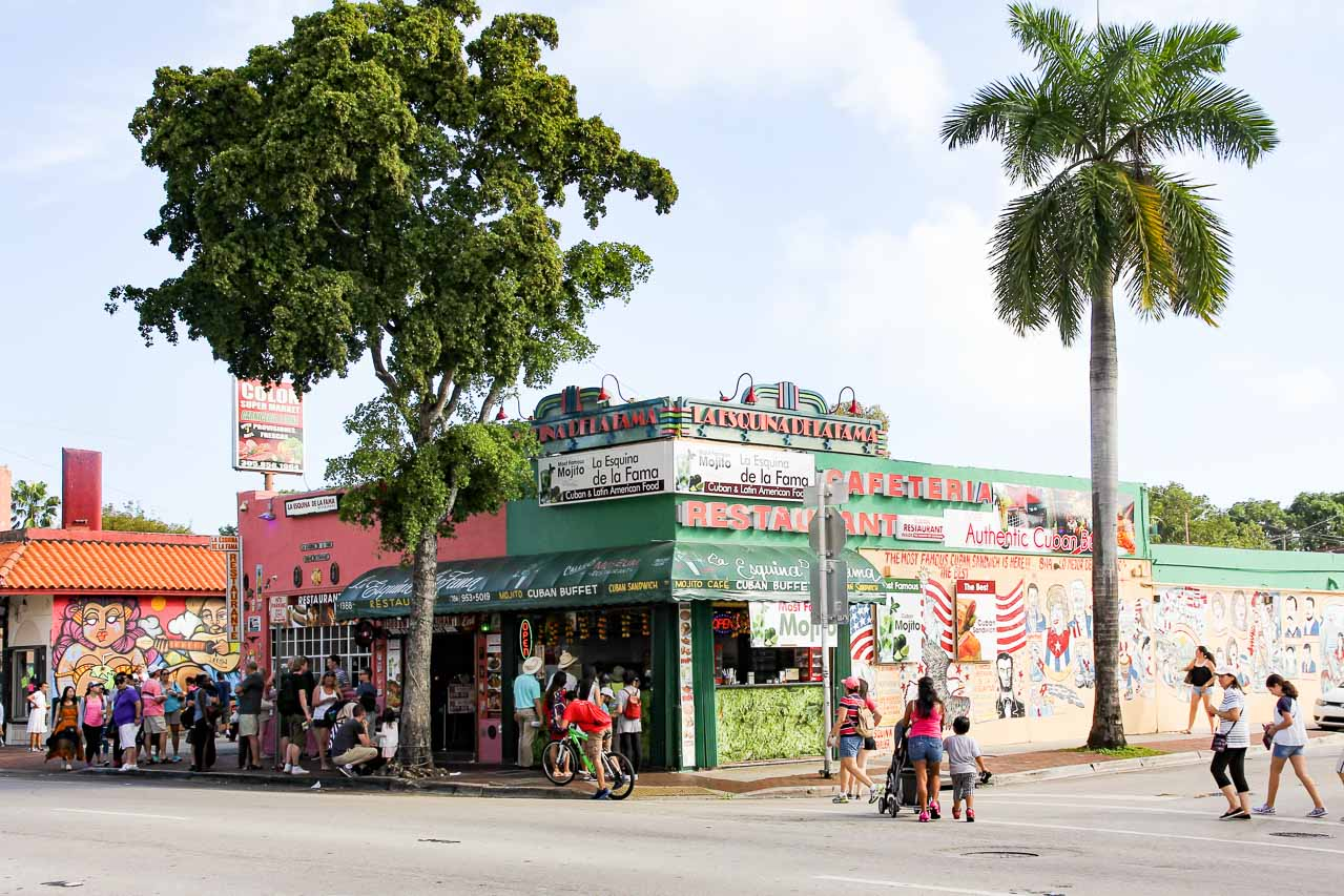People queuing outside La Esquina De La Fama restaurant on corner in Calle Ocho