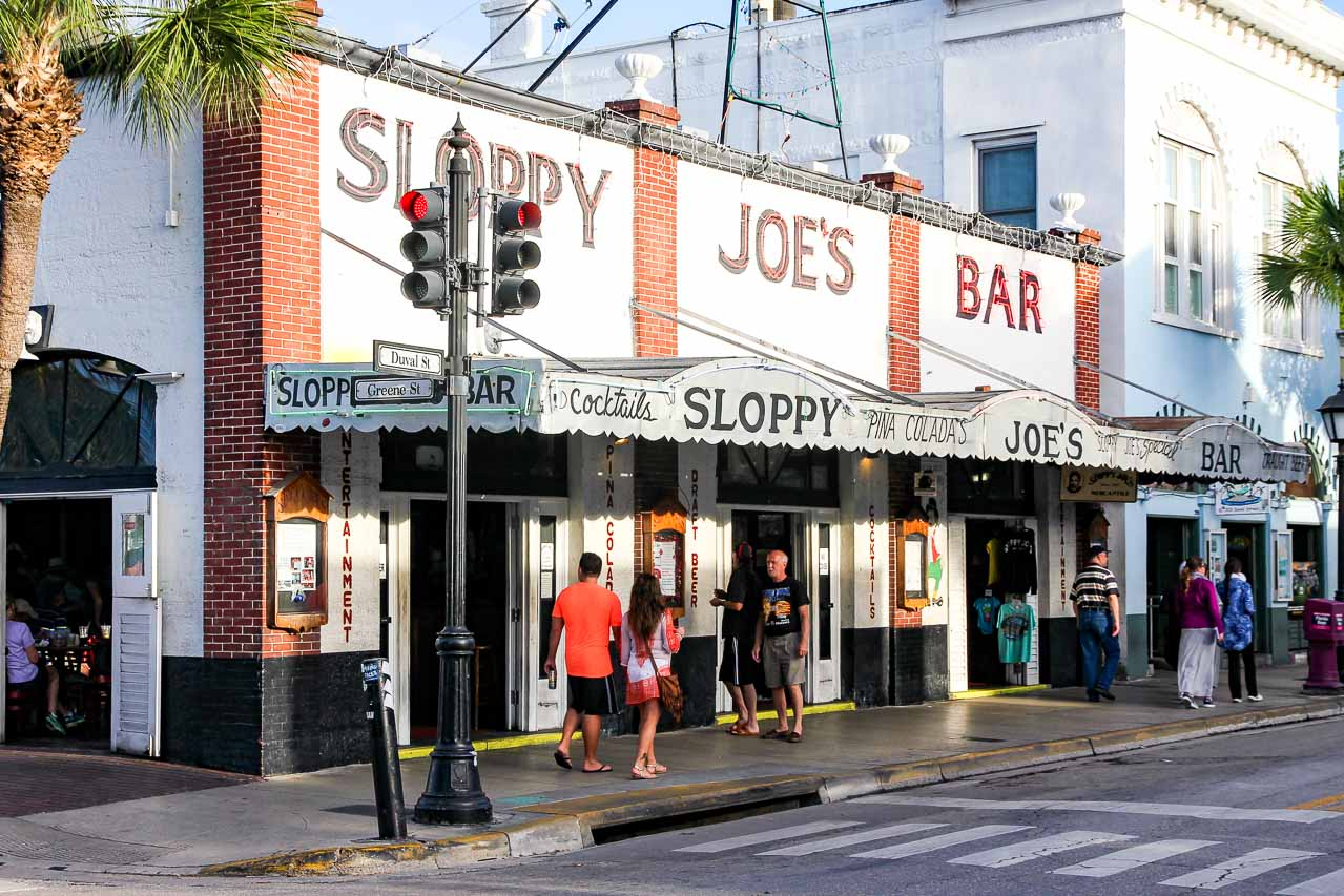 "Exterior of bar with large lettering reading ""Sloppy Joe's Bar"""