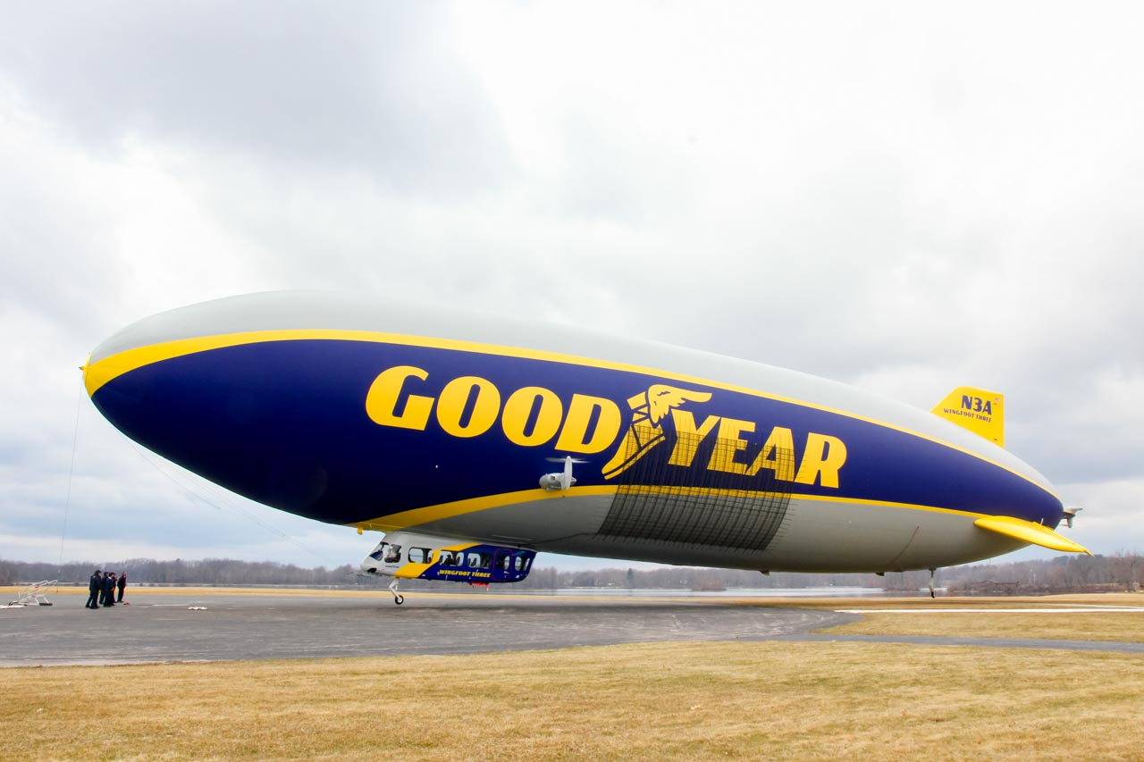 Goodyear Blimp floating just above the ground at the airdock