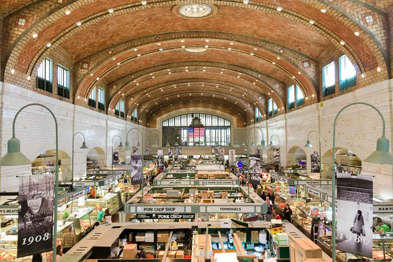 Photo of the interior of Westside Market with stall arched, brick ceiling.