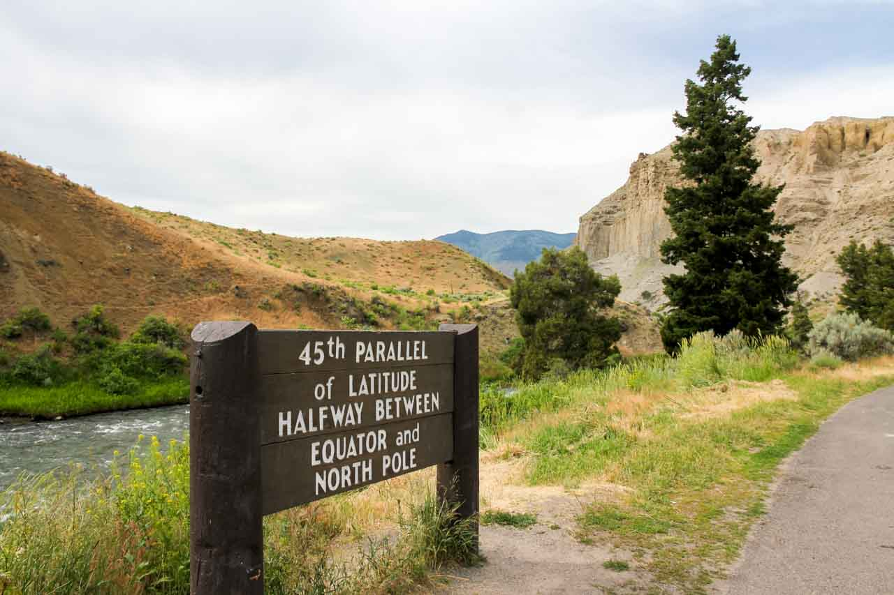 """Photo of sign reading """"45th Parallel of latitude. Halfway between Equator and North Pole""""."""