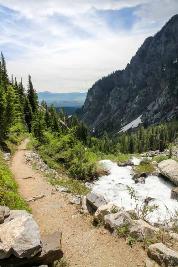 View down trail with valley on the right looking out to distant mountains