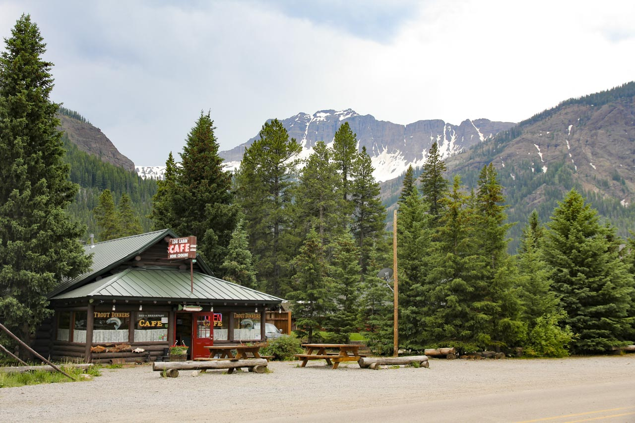Log Cabin Cafe with mountains and forest in background