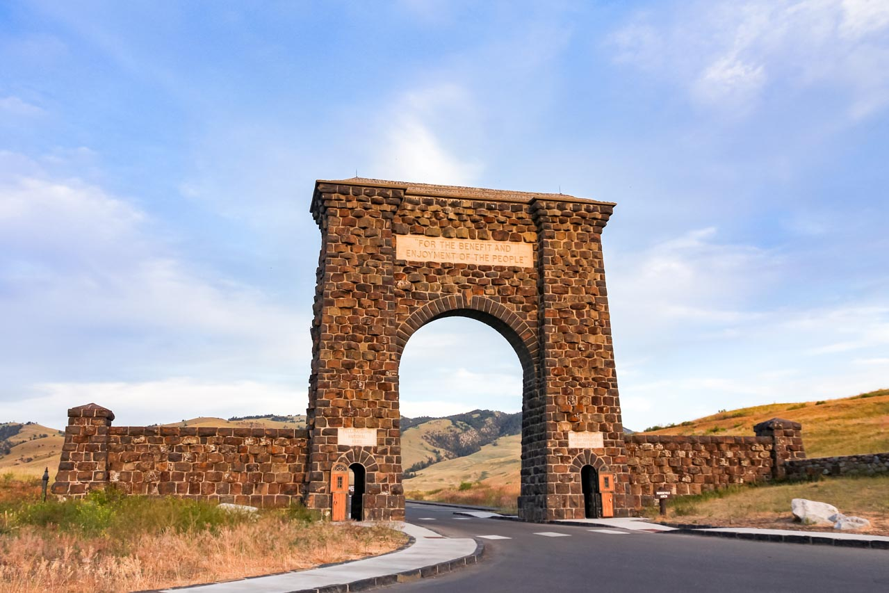 """Stone arch with enscription reading """"For the benefit and enjoyment of the people"""""""