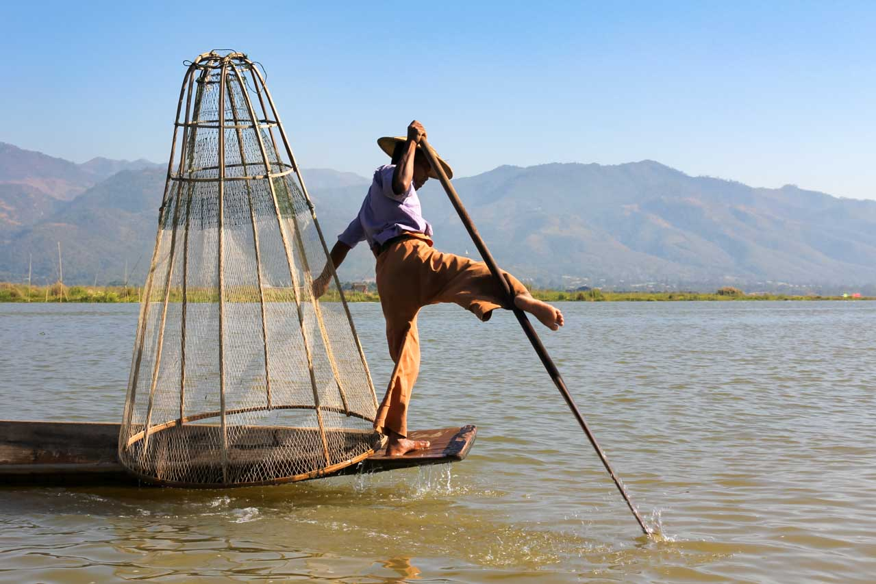 Intha fisherman performing the unique Inle Lake fishing style