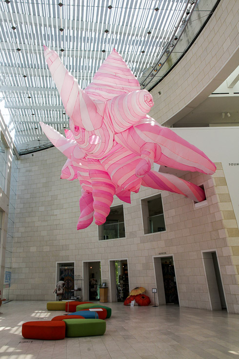 Abstract pink inflatable hanging from Museum ceiling