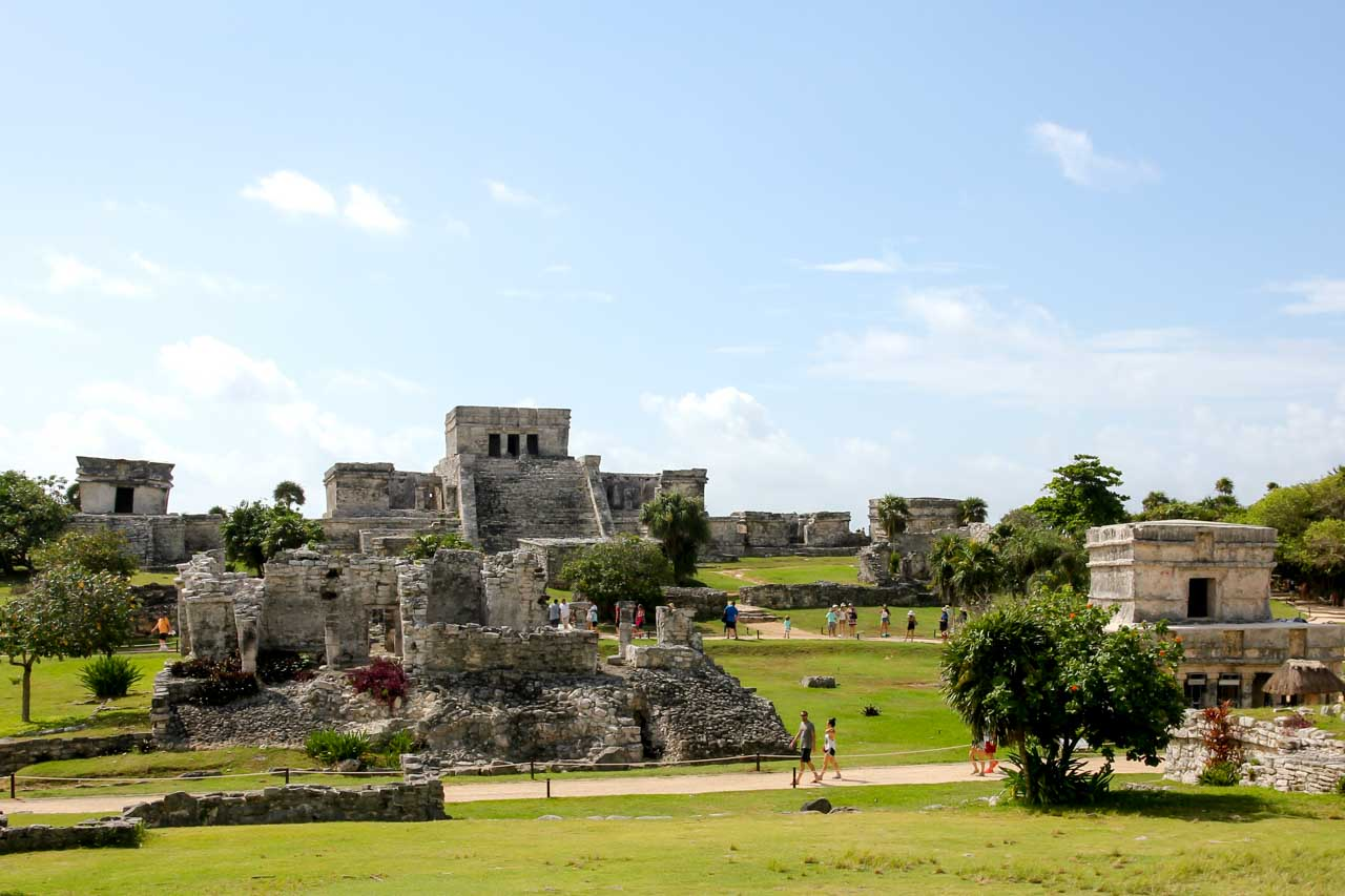 Photos of stone ruins with landscaped grounds and blue sky