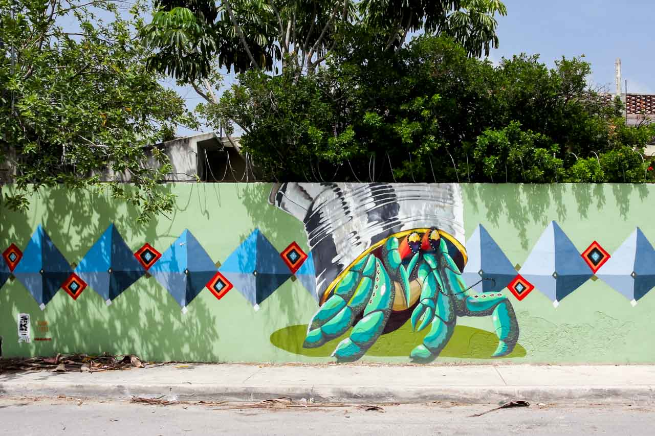 Mural of crab on wall with trees behind