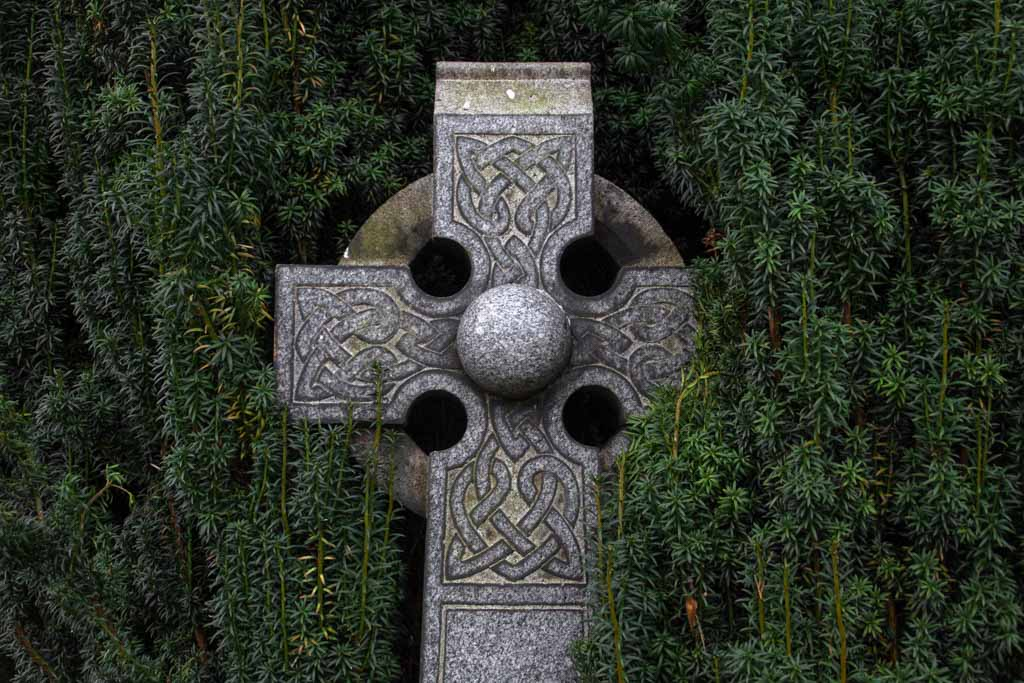 Celtic cross engraved with knotwork