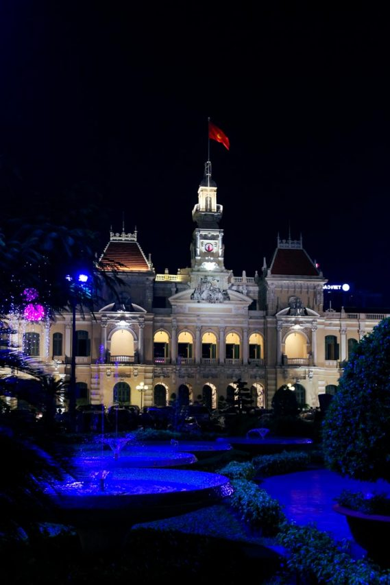 Ho Chi Minh City Hall at night with purple lights in the gardens