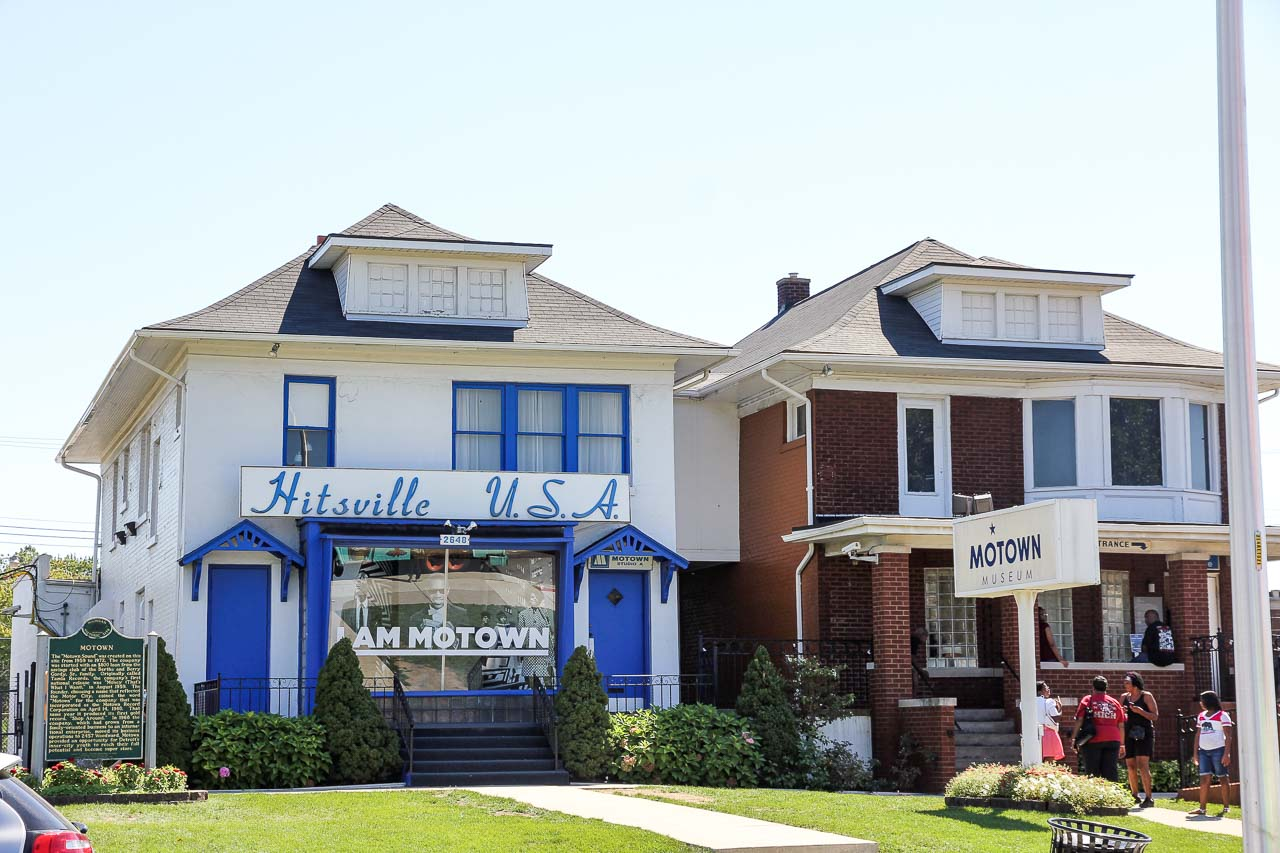 "Exterior of two similar homes with signs for ""Motown"" and ""Hitsville, USA"""