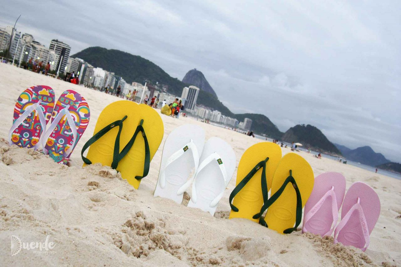 A row of Havianas on Copacabana Beach with Sugarloaf Mountain in the distance