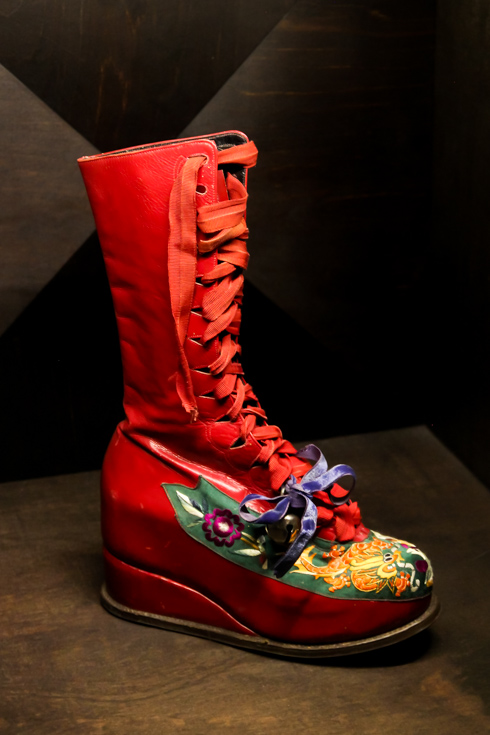 Frida's lace-up boot with Chinese embroidery and bells tied with a ribbon