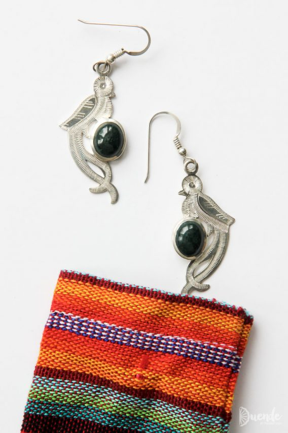 Jade and silver earrings in the shape of Quetzal birds