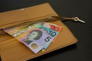 Image of Australian bank notes coming out of a tan purse