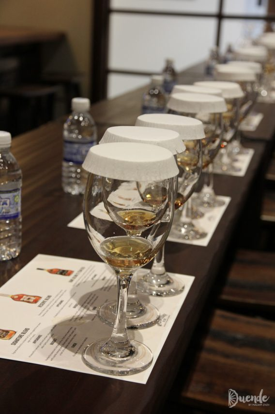 Line of glasses containing rum samples