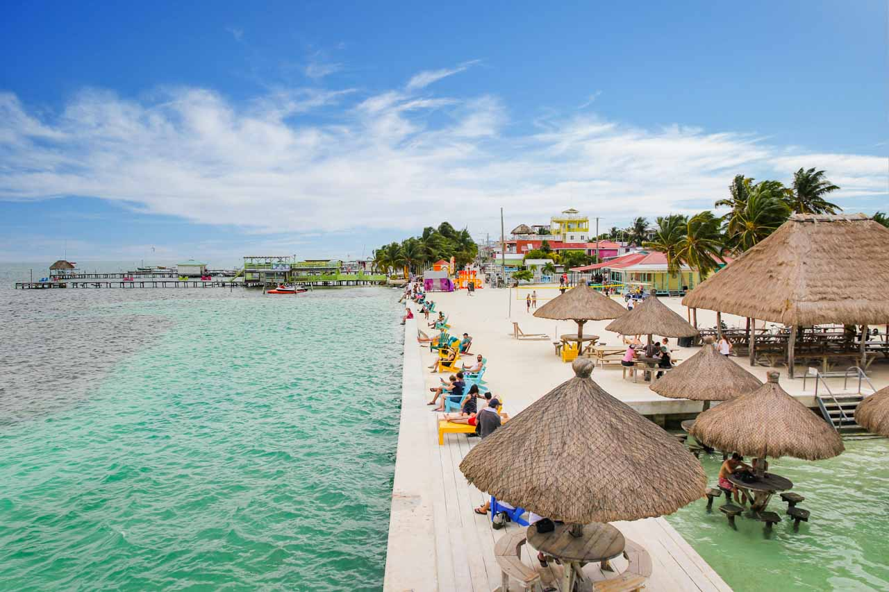 People enjoying the sun by the water on Caye Caulker.