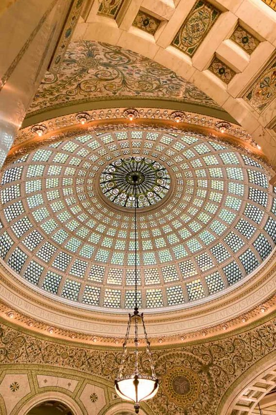 Photo of coloured glass dome with chandelier hanging from center