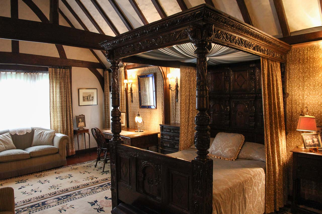Tudor revival bedroom with dark wood, four-poster bed