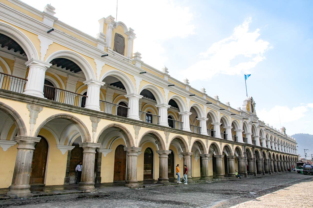 Large colonial building with arched colonnade