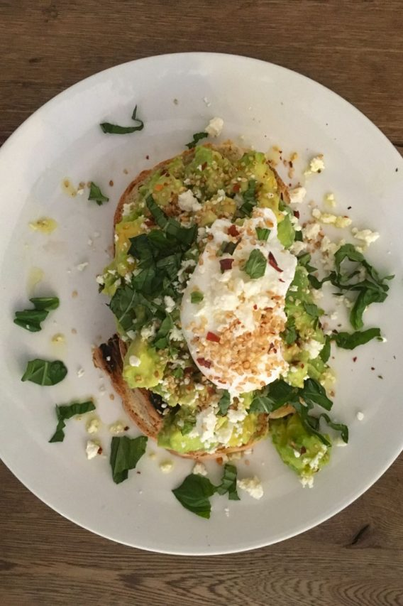 Avocado toast topped with poached egg