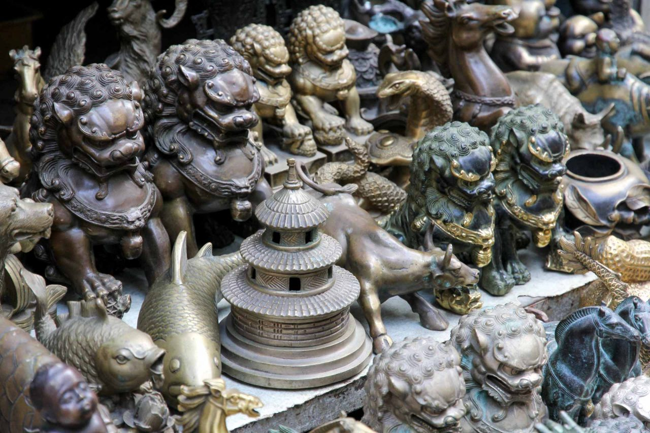 Fu dogs, carp and pagoda figurines on table