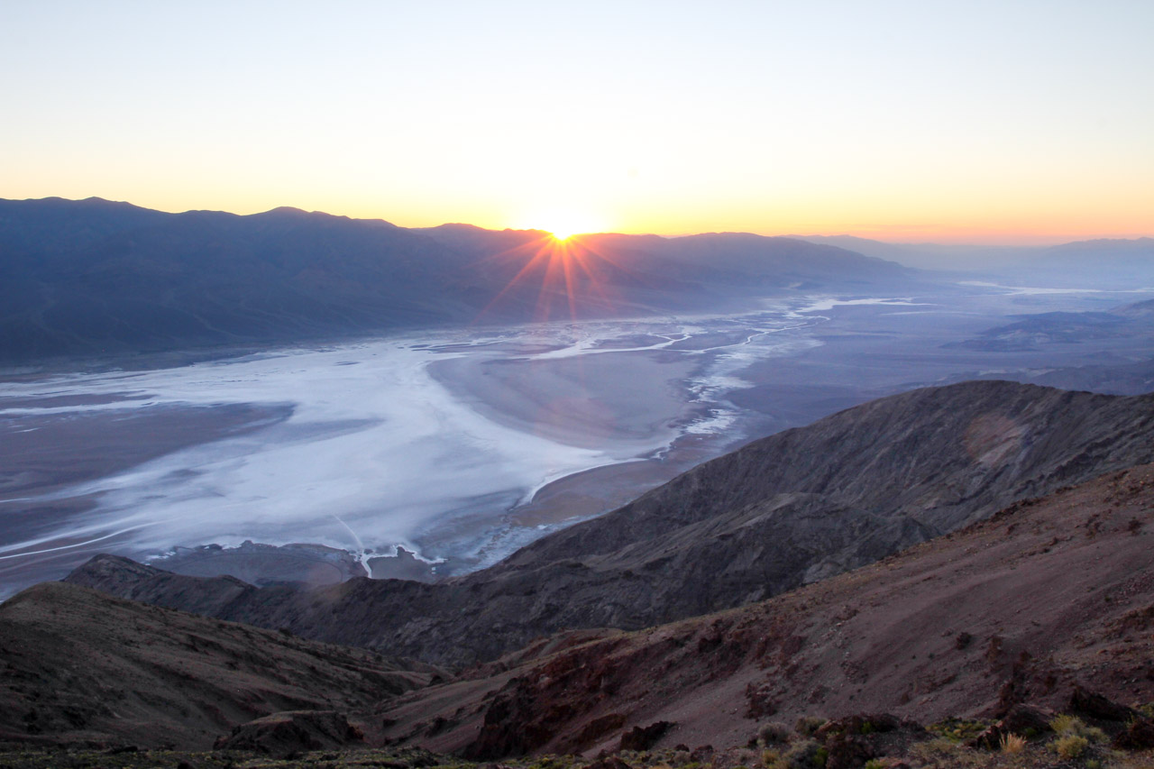 Sunset over desert mountains and valley