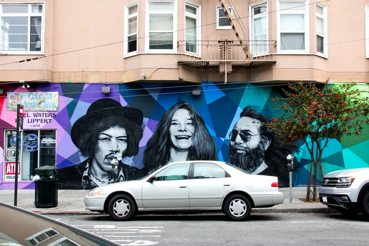 Mural with portraits of Jimi Hendrix, Janis Joplin and Jerry Garcia on geometric background
