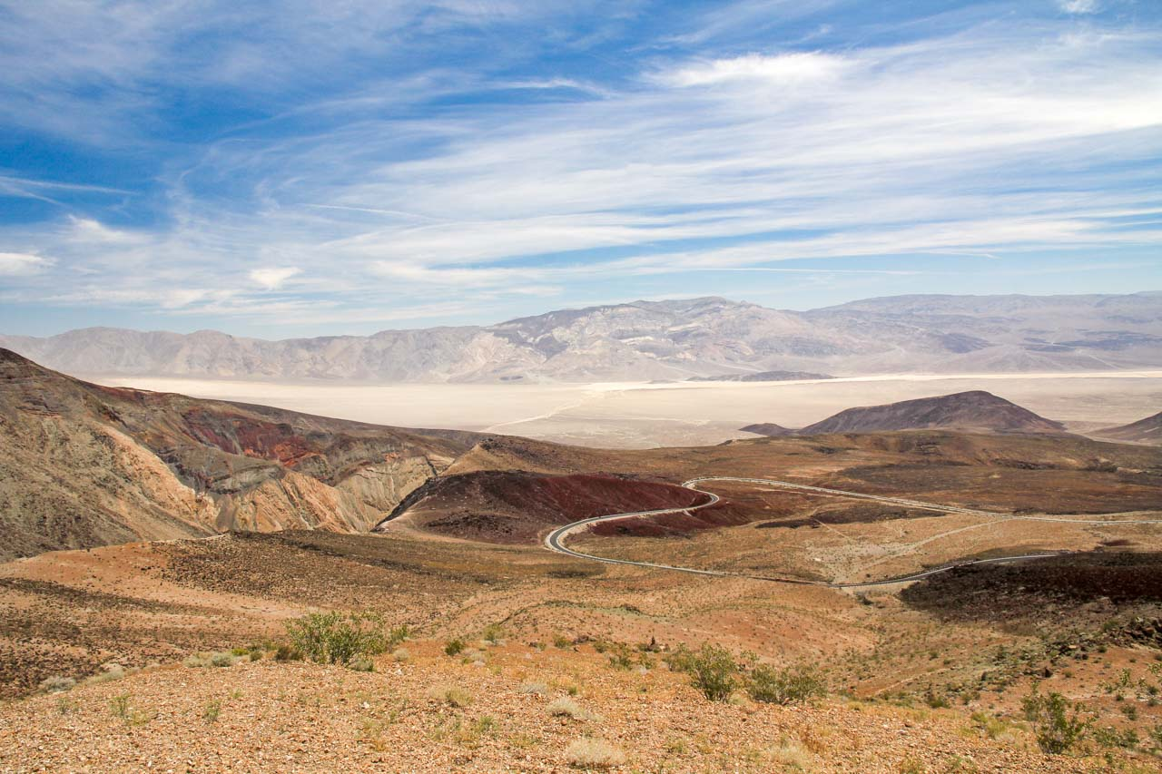 View over desert valley with winding road
