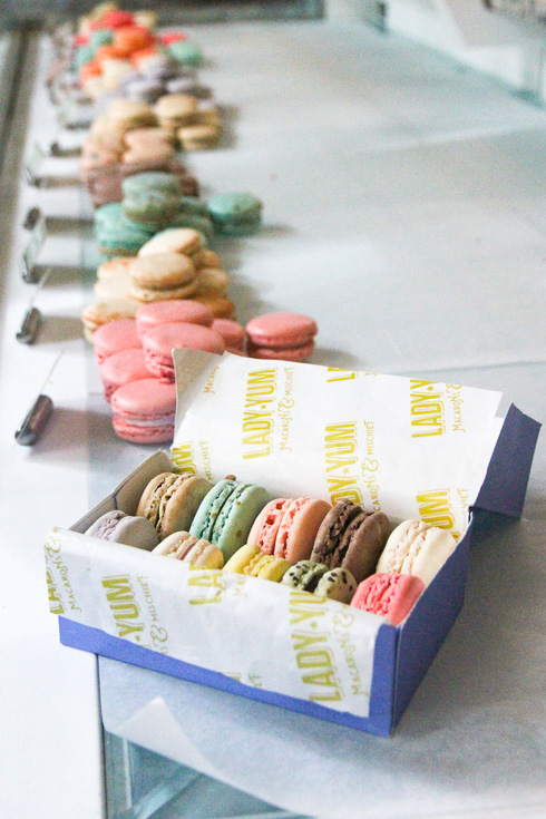 Window display of pastel coloured macarons
