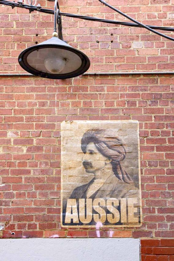 "Poster featuring portrait of Afghan man in turban with the word ""Aussie"" printed across the bottom"