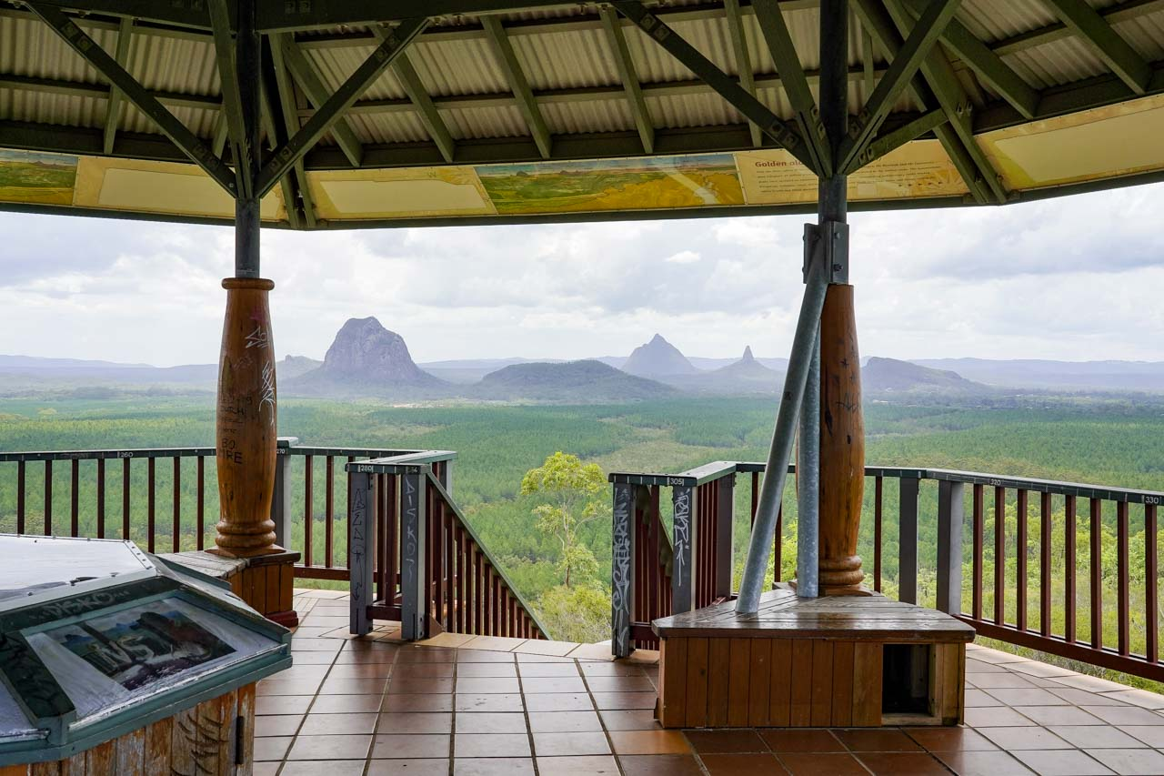 View of Glass House Mountains with interior of lookout in foreground