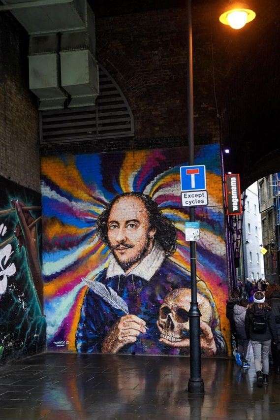 Photo of mural featuring portrait of Shakespeare on colourful background
