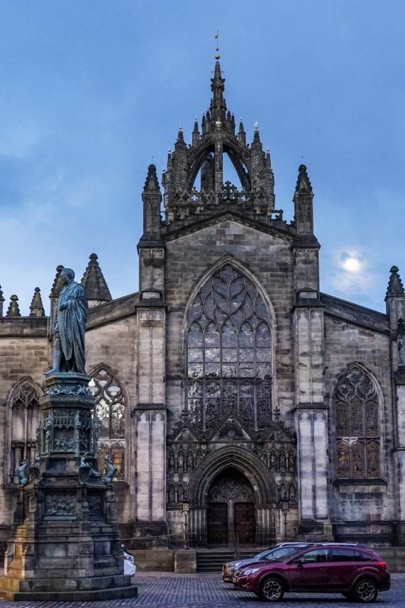 Photo of moon rising behind gothic cathedral