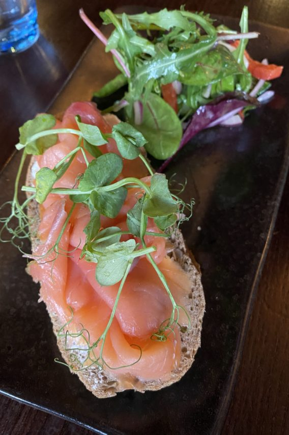 Scottish smoked salmon on bread with salad